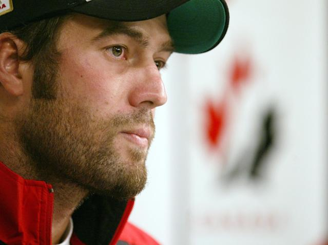 FILE - In this Aug. 15, 2005, file photo, Todd Bertuzzi of the Vancouver Canucks speaks to the media on the first day of training camp for the Canadian Men's Olympic Hockey Team in Vancouver. A settlement has been reached in Steve Moore's lawsuit against Bertuzzi for his career-ending hit during an NHL game 10 years ago. (AP Photo/The Canadian Press, Richard Lam, File)