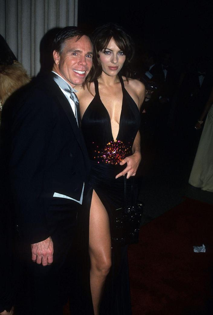 """<p>Posing with fashion designer Tommy Hilfiger at the Met Gala in 1999 for the """"Rock Style"""" theme.</p>"""