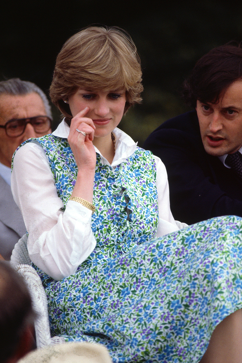 <p>Here's another one of Diana's polo outfits - a sleeveless floral dress layered over a relaxed, unbuttoned shirt.</p>