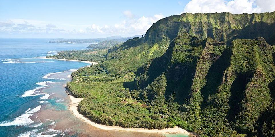 """<p><a href=""""https://www.bestproducts.com/fun-things-to-do/g3374/things-to-do-in-hawaii-attractions-activities/"""" rel=""""nofollow noopener"""" target=""""_blank"""" data-ylk=""""slk:Kauai"""" class=""""link rapid-noclick-resp"""">Kauai</a> is one of the lushest places on Earth, and its most famous natural attraction is the <a href=""""https://www.tripadvisor.com/Attraction_Review-g9777534-d146816-Reviews-Na_Pali_Coast_State_Park-Wainiha_Kauai_Hawaii.html"""" rel=""""nofollow noopener"""" target=""""_blank"""" data-ylk=""""slk:Na Pali Coast"""" class=""""link rapid-noclick-resp"""">Na Pali Coast</a>. This stretch of incredibly rugged coastline on the island's North Shore is brimming with emerald green cliffs, cascading waterfalls, and tropical plants and flowers. The 11-mile <a href=""""https://www.tripadvisor.com/Attraction_Review-g29218-d102945-Reviews-Kalalau_Trail-Kauai_Hawaii.html"""" rel=""""nofollow noopener"""" target=""""_blank"""" data-ylk=""""slk:Kalalau Trail"""" class=""""link rapid-noclick-resp"""">Kalalau Trail</a> is not for the faint of heart, but if you're up to the challenge, you'll be rewarded with once-in-a-lifetime views.</p>"""