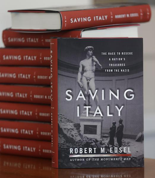 This photo taken April 29, 2013 shows copies of the book titled Saving Italy by Robert Edsel, founder of the Monuments Men Foundation for the Preservation of Art, in Dallas. Edsel started his foundation in 2007 to honor and continue the work of the Monuments Men, the roughly 345 men and women from 13 nations who helped protect cultural treasures during World War II. (AP Photo/LM Otero)