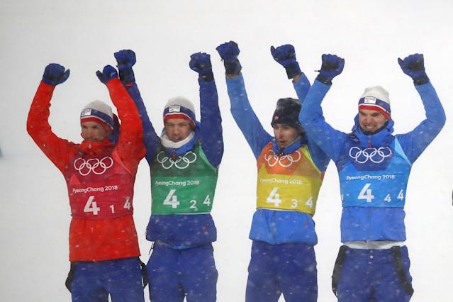 Nordic Combined Events - Pyeongchang 2018 Winter Olympics - Men's Team 4 x 5 km Final - Alpensia Cross-Country Skiing Centre - Pyeongchang, South Korea - February 22, 2018 - Jan Schmid, Espen Andersen, Jarl Magnus Riiber and Joergen Graabak of Norway celebrate winning silver. REUTERS/Carlos Barria
