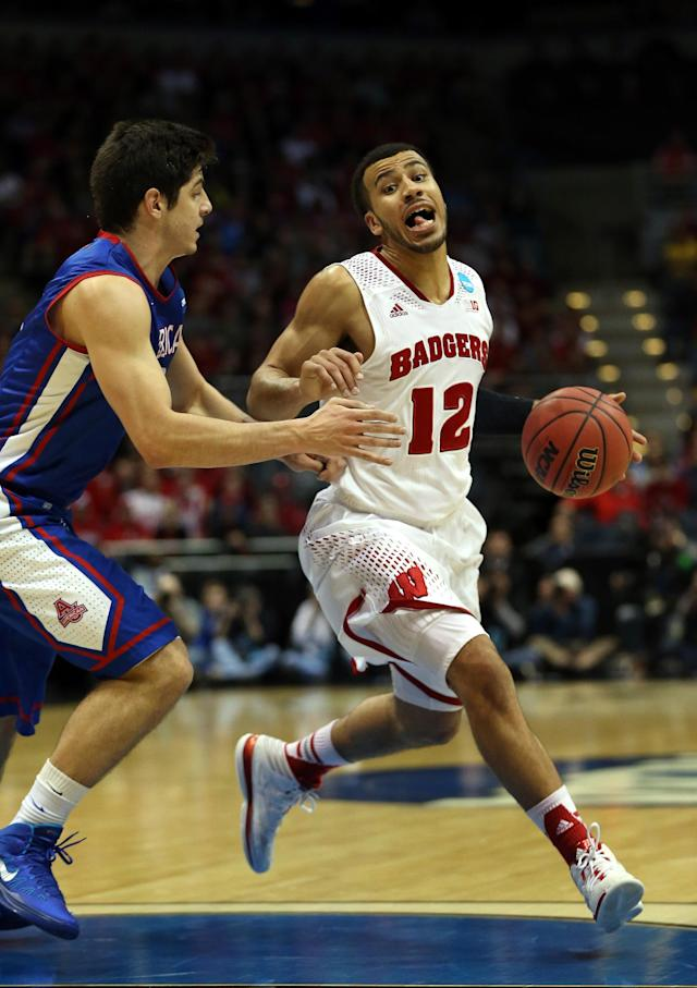 MILWAUKEE, WI - MARCH 20: Traevon Jackson #12 of the Wisconsin Badgers controls the ball during the second round game of NCAA Basketball Tournament against the American University Eagles at BMO Harris Bradley Center on March 20, 2014 in Milwaukee, Wisconsin. (Photo by Jonathan Daniel/Getty Images)
