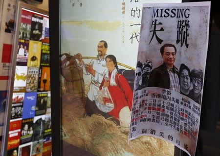 A printout showing Lee Bo, specializing in publications critical of China, and four other colleagues who went missing, is displayed outside a bookstore at Causeway Bay shopping district in Hong Kong