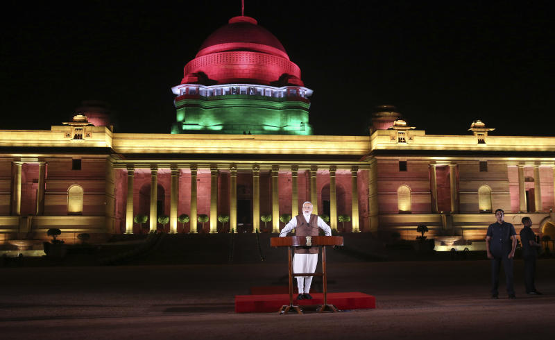 Indian Prime Minister Narendra Modi addresses the media after meeting with the President to stake claim to form the government in New Delhi, India, Saturday, May 25, 2019. Newly elected lawmakers from India's ruling alliance led by the Hindu nationalist Bharatiya Janata Party elected Narendra Modi as their leader on Saturday, paving the way for his second five-year term as prime minister after a thunderous victory in national elections. (AP Photo/Manish Swarup)