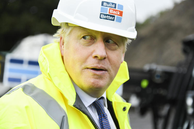 Britain's Prime Minister Boris Johnson visits the Conway Heathrow Asphalt & Recycling Plant construction site in west London, Saturday, Oct. 3, 2020. (AP Photo/Alberto Pezzali)