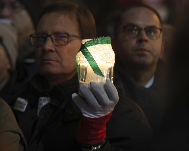 Demonstrators hold a rally to protest against changes to Poland's judiciary planned by the ruling Law and Justice party near the building of parliament in Warsaw, Poland, Wednesday, Dec. 18, 2019. (AP Photo/Czarek Sokolowski)