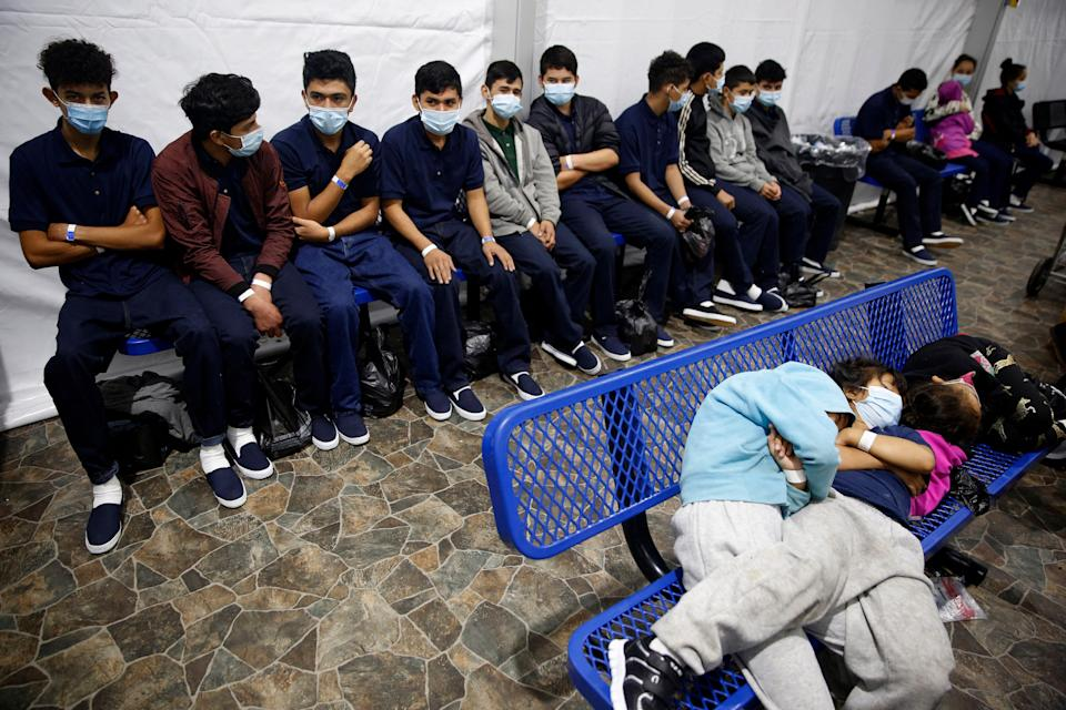 Young unaccompanied migrants wait for their turn at the secondary processing station inside the Donna Department of Homeland Security holding facility, the main detention center for unaccompanied children in the Rio Grande Valley in Donna, Texas, March 30, 2021.
