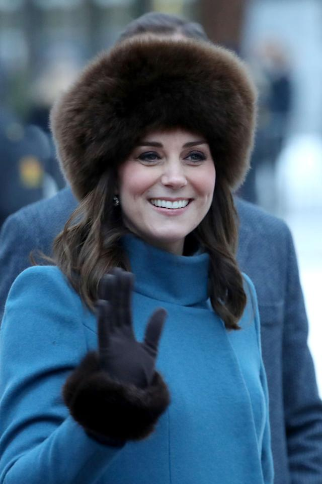 <p><strong>When: Feb. 1, 2018</strong><br />On day 3 of their tour of Scandinavia, Kate and Prince William visited the Princess Ingrid Alexandra Sculpture Park within the Royal Palace Gardens — <em>in style</em>. The Duchess marked the occasion in a long slate blue Catherine Walker coat, faux fur cuffs in black (£40.00/$70 CAD) by Troy London and topped it off with a warm sumac Alpaca fur Lacorine hat in chocolate (£225.00/$393 CAD). <em>(Photo: Getty)</em> </p>