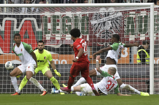 Munich's Serge Gnabry, center, scores his side's 2nd goal during a German Bundesliga soccer match between FC Augsburg and Bayern Munich in Augsburg, Germany, Saturday, Oct.19, 2019. (Stefan Puchner/dpa via AP)