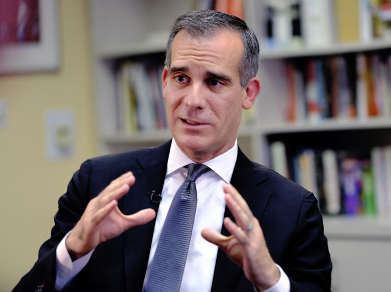 FILE - In this Aug. 16, 2018 file photo, Los Angeles Mayor Eric Garcetti talks during an interview about homelessness in Los Angeles. Garcetti says he hopes President Donald Trump will work with the city to end homelessness as the president visits California for a series of fundraisers. Garcetti says the federal government could aid Los Angeles with surplus property or money to create additional shelters. Garcetti says he has not been invited to meet with the president. (AP Photo/Richard Vogel, File)