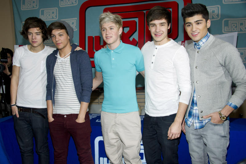 "FILE - In this March 12, 2012 file photo, One Direction band members Harry Styles, from left, Louis Tomlinson, Niall Horan, Liam Payne and Zayn Malik attend a CD signing at J&R Music World in New York. One Direction's debut album ""Up All Night""  entered the US Billboard 200 chart at #1 with over 176,000 copies sold.  (AP Photo/Charles Sykes, file)"