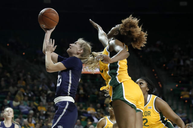New Hampshire guard Caroline Soucy (33) goes up for basket after getting past Baylor guard DiDi Richards, right, in the first half of an NCAA college basketball game in Waco, Texas, Tuesday, Nov. 5, 2019. (AP Photo/Tony Gutierrez)