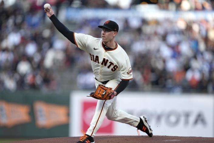 San Francisco Giants starting pitcher Anthony DeSclafani throws to a Los Angeles Dodgers batter during the first inning of a baseball game Wednesday, July 28, 2021, in San Francisco. (AP Photo/Tony Avelar)