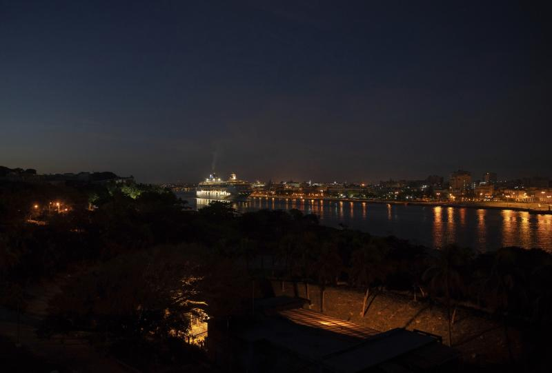 A ship of Norwegian Cruise Line leaves the bay of Havana at dawn, in Havana, Cuba, Wednesday, June 5, 2019. The Trump administration has imposed major new travel restrictions on visits to Cuba by U.S. citizens, banning stops by cruise ships and ending a heavily used form of educational travel as it seeks to further isolate the communist government. (AP Photo/Ramon Espinosa)