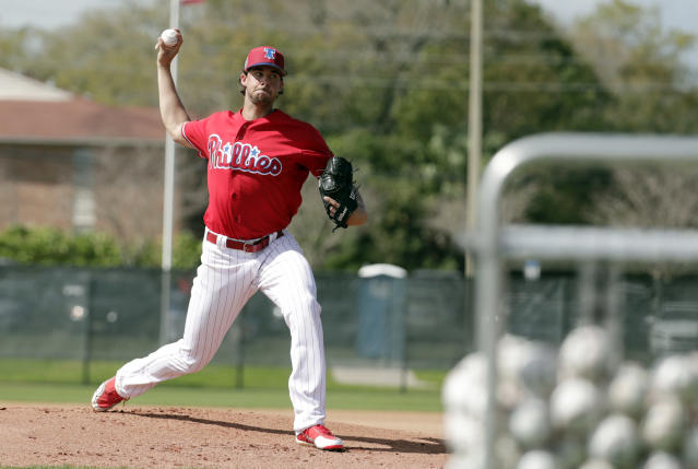 FILE - In this Feb. 20, 2018, file photo, Philadelphia Phillies starting pitcher Aaron Nola throws during batting practice at baseball spring training camp, Tuesday, Feb. 20, 2018, in Clearwater, Fla. Nola is the undisputed ace on a pitching staff that has plenty of potential but lacks proven talent. (AP Photo/Lynne Sladky, File)