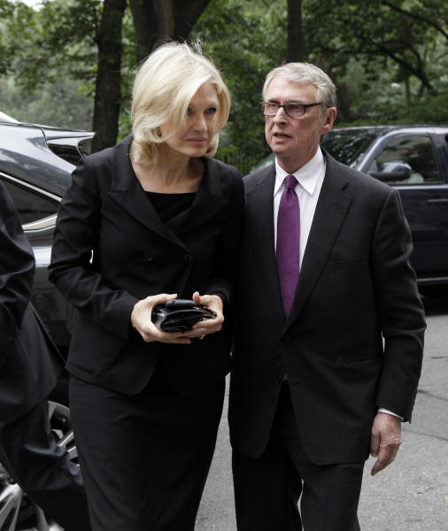 """Broadcaster Diane Sawyer and her husband, director Mike Nichols, arrive for the funeral of Marvin Hamlisch, in New York's Temple Emanu-El, Tuesday, Aug. 14, 2012. Hamlisch composed or arranged hundreds of scores for musicals and movies, including """"A Chorus Line"""" on Broadway and the films """"The Sting,"""" ''Sophie's Choice,"""" ''Ordinary People"""" and """"The Way We Were."""" He won three Oscars, four Emmys, four Grammys, a Tony, a Pulitzer and three Golden Globes. Hamlisch died Aug. 6 in Los Angeles at age 68. (AP Photo/Richard Drew)"""