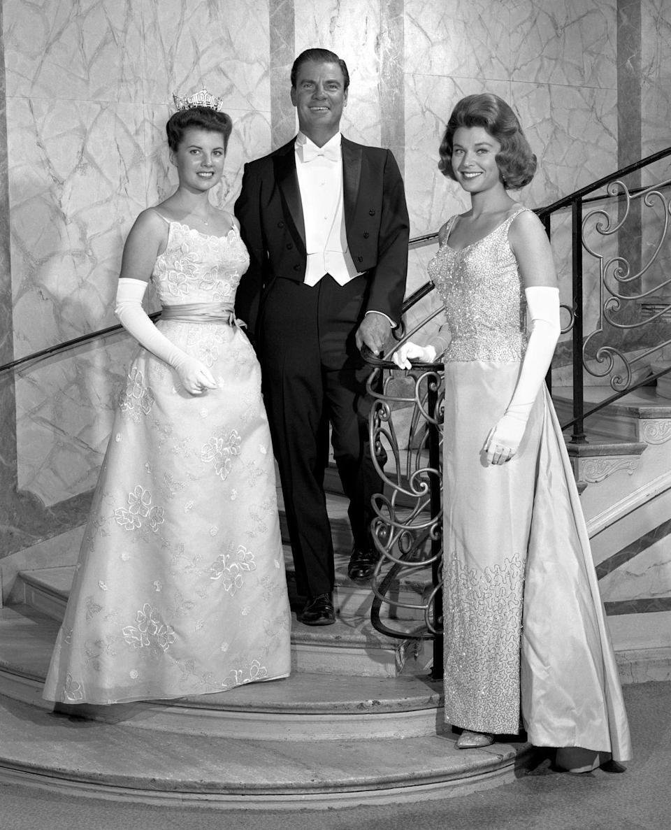 <p>Jacquelyn Mayer of Ohio, left, is the definition of pageant royalty in her floral embroidered gown. Everything about the outfit—from her satin sash to her elegant white gloves—looks straight out of a Disney movie. </p>