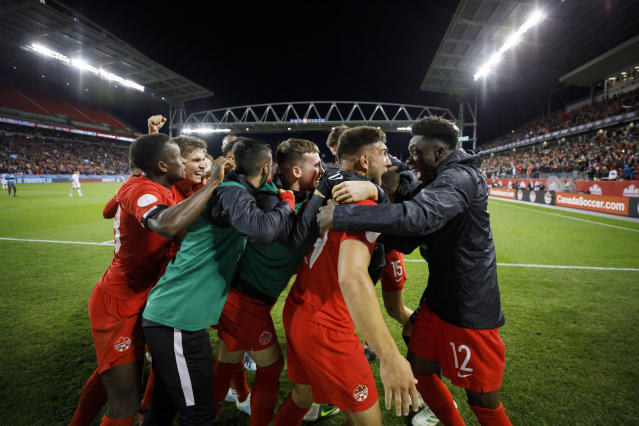Canada midfielder Alphonso Davies (12) looks at forward Lucas Cavallini as they celebrate Cavallini's goal against the United States during the second half of a CONCACAF Nations League soccer match Tuesday, Oct. 15, 2019, in Toronto. (Cole Burston/The Canadian Press via AP)