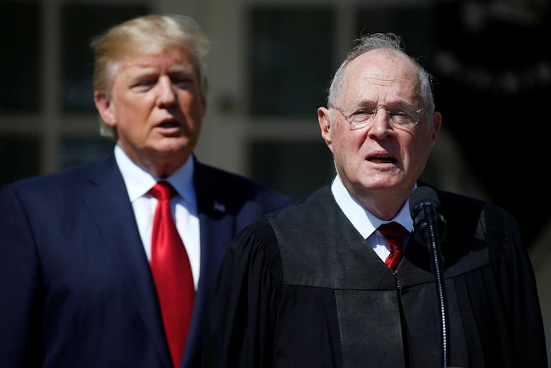 President Donald Trump listens as Justice Anthony Kennedy speaks before swearing in Neil Gorsuch to the Supreme Court in April 2017.
