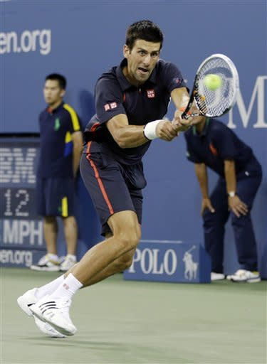 Novak Djokovic, of Serbia, returns a shot to Paolo Lorenzi, of Italy, during a match at the U.S. Open tennis tournament Tuesday, Aug. 28, 2012 in New York. (AP Photo/Darron Cummings)
