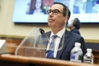Treasury Secretary Steven Mnuchin listens to a question during a House Financial Services Committee hearing on Capitol Hill in Washington, Wednesday, Dec. 2, 2020. (Greg Nash/Pool via AP)