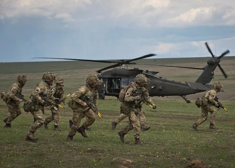 "British soldiers participate in the NATO ""Wind Spring 15"" military exercise at the Smardan military shooting range in Romania in April 2015 (AFP Photo/Daniel Mihailescu)"