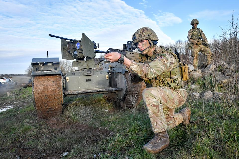 Soldiers surround a Titan Strike unmanned ground vehicle.  (Photo by Ben Birchall / PA Images via Getty Images)