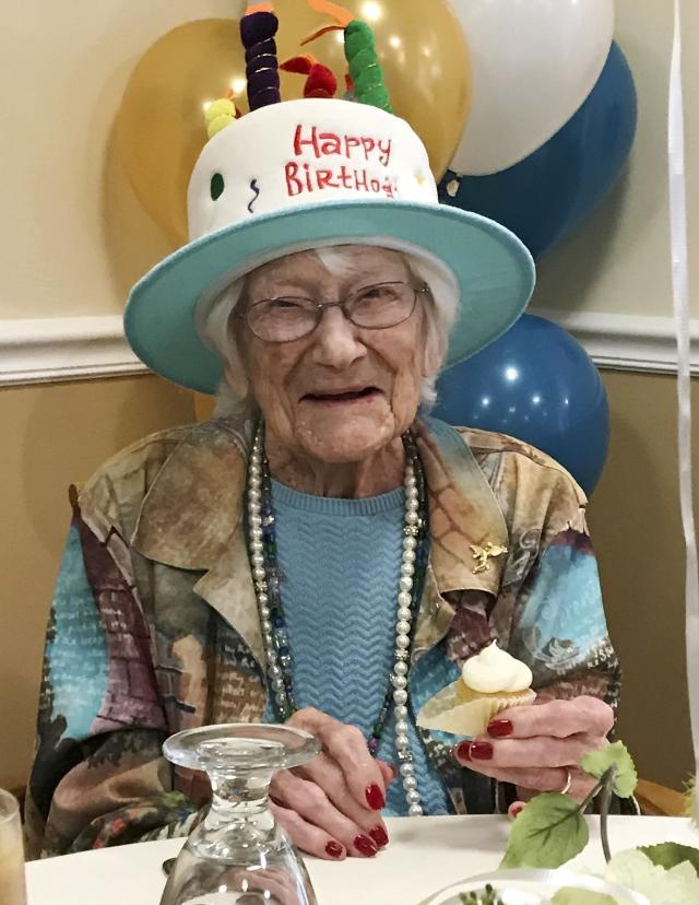 In this photo provided by Tony Venti, Hazel Nilson celebrates her 111th birthday with a peach cupcake, Wednesday, Aug. 21, 2019, at Sunapee Cove in Sunapee, N.H. A lifelong Chicago Cubs fan, Nilson was born on Aug. 21, 1908, in Chicago. (Tony Venti via AP)