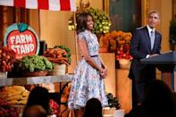 U.S. first lady Michelle Obama (C) and President Barack Obama confess that their favorite junk foods are french fries (her) and chips and guacamole (him) as they play host to a Kids State Dinner for children who won a healthy-foods recipe contest, at the White House in Washington July 18, 2014. REUTERS/Jonathan Ernst/File Photo