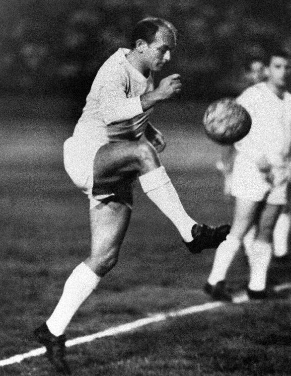 FILE - In this Aug. 25, 1963 file photo, Alfredo di Stefano controls the ball during the first game of the Little World Cup Series, in Caracas, Venezuela. Di Stefano, whose goals placed him alongside the all-time great players and propelled Real Madrid to five straight European Champions Cups, has died on Monday, July 7, 2014. He was 88. (AP Photo/File)
