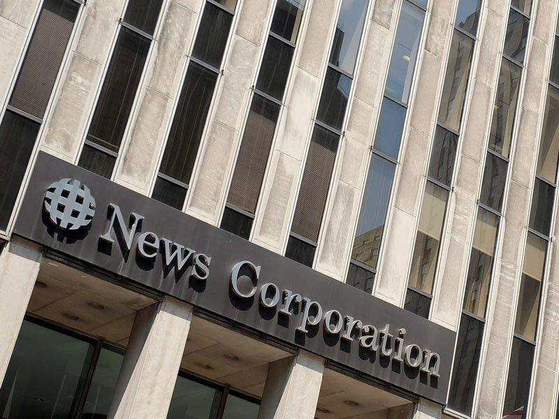 Newspapers force News Corp loss