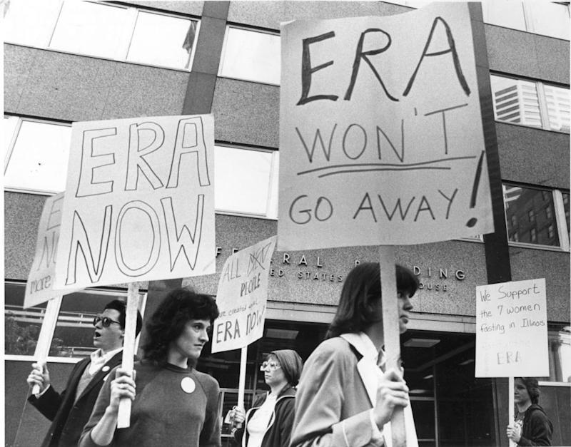 Demonstrators picketed outside the Federal Building in Minneapolis, June 9, 1982, in support of the Equal Rights Amendment and in silent vigil in support of seven fasting ERA supporters in Illinois.   Star Tribune via Getty Images—Star Tribune via Getty Images