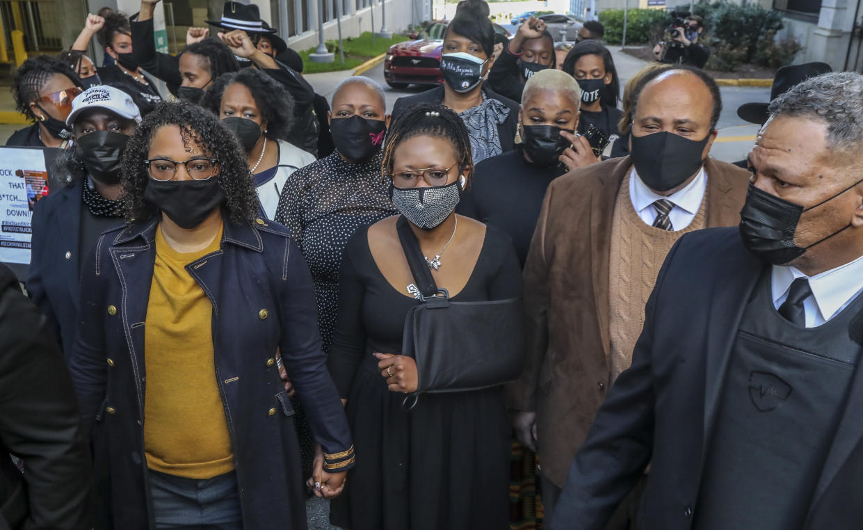 GA State Rep. Renitta Shannon, GA State Rep Park Cannon, Martin Luther King III march silently along Mitchell Street in front of the Capitol. (John Spink/AJC via Getty Images)