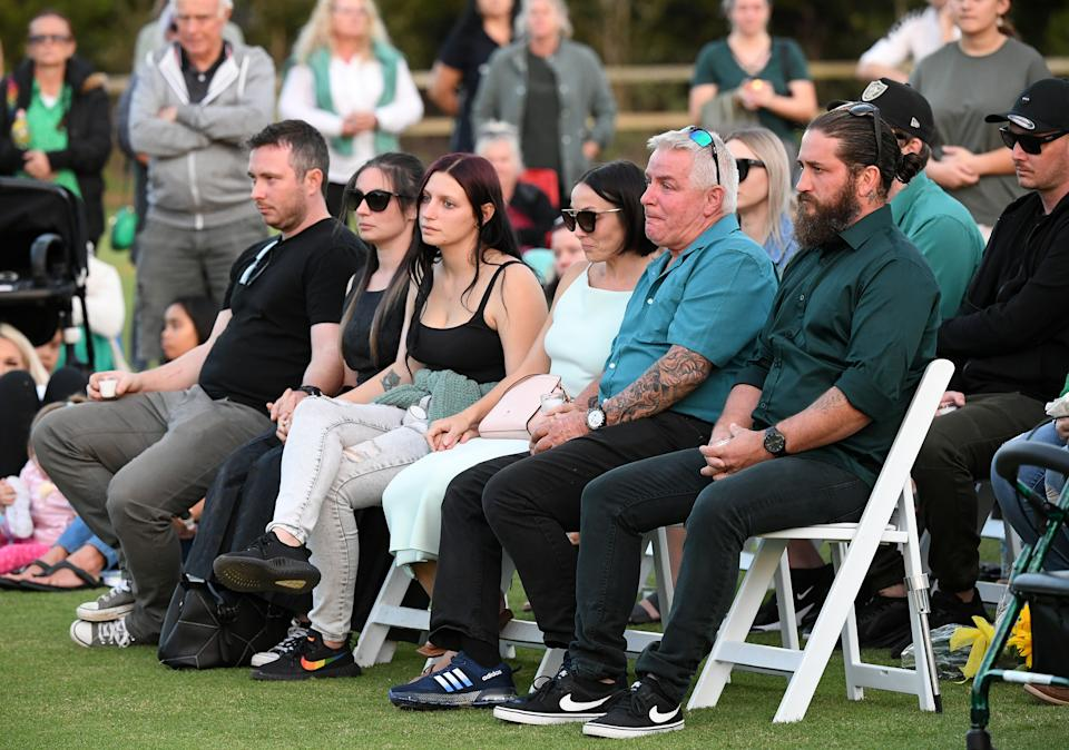 The family of Kelly Wilkinson, Ms Carroll pictured third right, at a vigil for the mother-of-three. Source: AAP