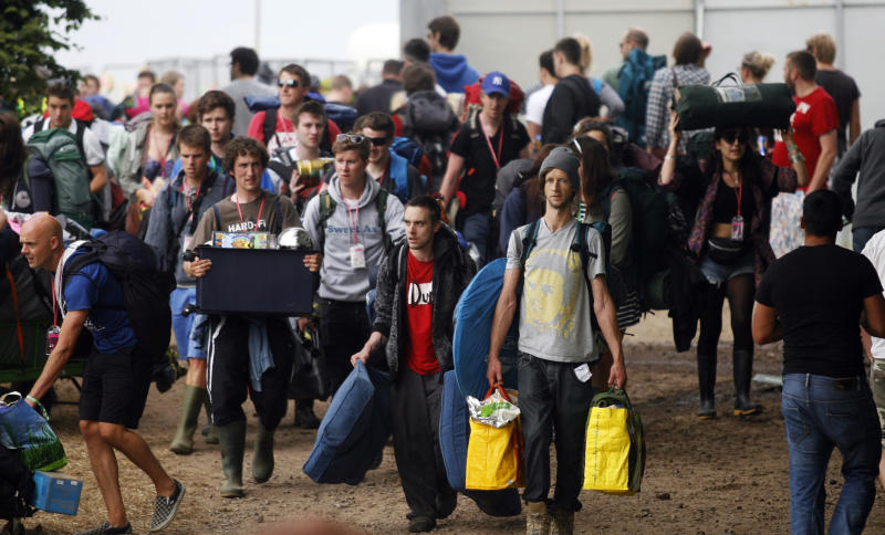 Festival goers arrive at the Glastonbury Music Festival site in Glastonbury England Wednesday, June 26, 2013. Thousands are to arrive for the three day festival that starts on Friday, June 28 2013 with headliners, Arctic Monkeys, the Rolling Stones and Mumford and Sons. (Photo by Jim Ross/Invision/AP)