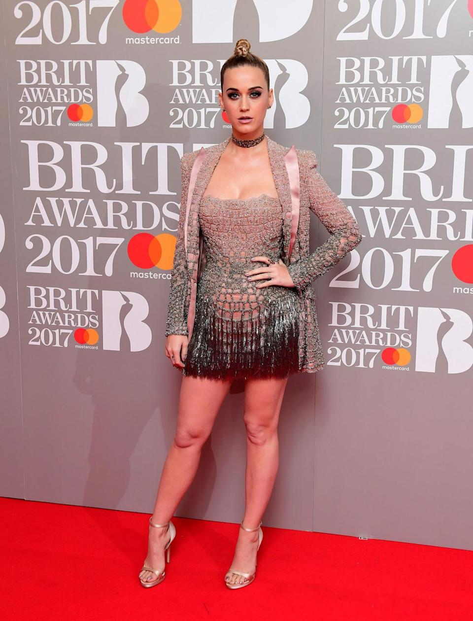 <p>Katy donned an incredibly short embellished Versace dress and matching jacket. <i>[Photo: PA]</i> </p>