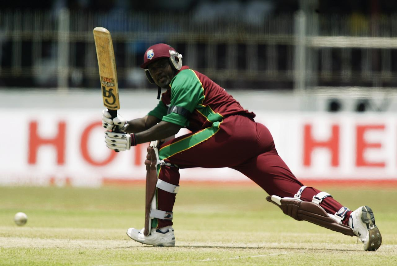 COLOMBO - SEPTEMBER 13:  Carl Hooper of West Indies in action during the ICC Champions Trophy match between South Africa and West Indies held on September 13, 2002 at the SSC Stadium, in Colombo, Sri Lanka. DIGITAL IMAGE. (Photo by Clive Mason/Getty Images)