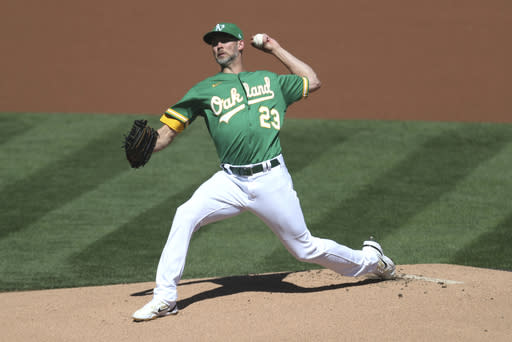 Oakland Athletics' Mike Minor pitches against the Seattle Mariners' during the first inning of the first baseball game of a doubleheader in Oakland, Calif., Saturday, Sept. 26, 2020. (AP Photo/Jed Jacobsohn)