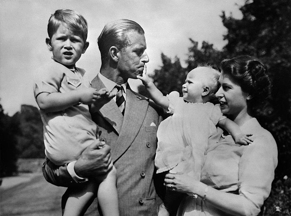 <p>With their eldest children, Prince Charles and Princess Anne.</p>