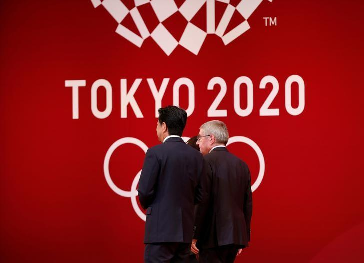 FILE PHOTO : IOC President Bach walks with Japan's PM Abe during the 'One Year to Go' ceremony celebrating one year out from the start of the summer games in Tokyo