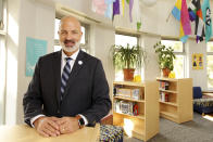 """St. Paul public school Superintendent Joe Gothard stands for a portrait at Como Park High School in St. Paul, Minn., on Saturday, Aug. 21, 2021, where new federal school funding will help to hire staff, buy books and be used for building renovations. """"It's about managing expectations, honestly, and it starts with myself. We really have to be careful about avoiding a financial cliff."""" (AP Photo/Andy Clayton-King)"""