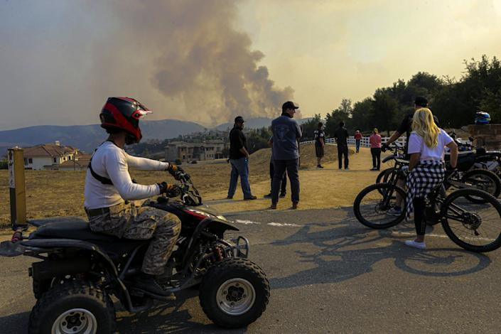 Residents watch the Blue Ridge fire from Vellano Club Drive on Tuesday in Chino Hills.