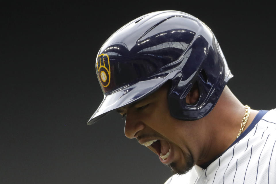 Milwaukee Brewers' Eduardo Escobar reacts after reaching base on a throwing error during the seventh inning of a baseball game against the New York Mets, Sunday, Sept. 26, 2021, in Milwaukee. Two runs scored on the play. (AP Photo/Aaron Gash)