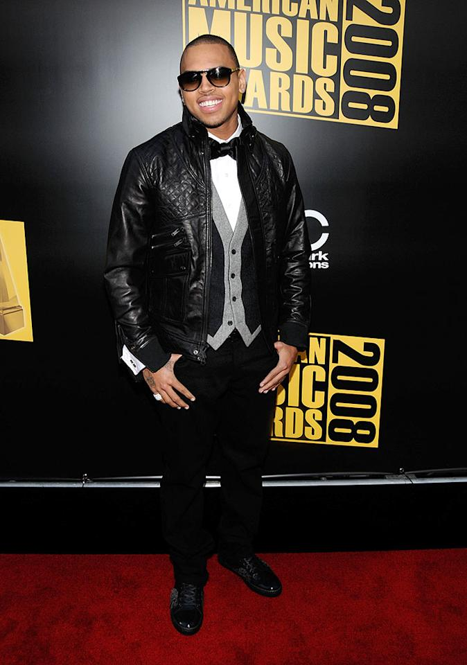 """Chris Brown was all smiles even before taking home the biggest award of the night: Artist of the Year. Unfortunately, the 19-year-old heartthrob missed the mark in his leather jacket and girlie sunglasses. Kevin Mazur/<a href=""""http://www.wireimage.com"""" target=""""new"""">WireImage.com</a> - November 23, 2008"""
