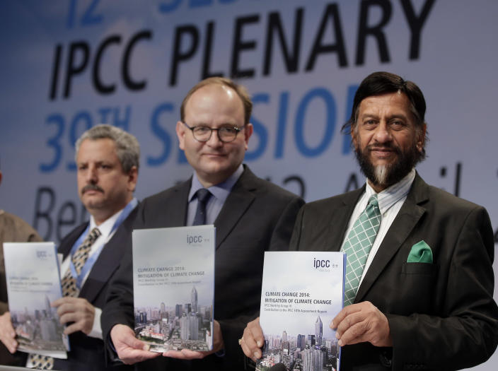 Ramon Pichs Madruga, Co-Chairman of the IPCC Working Group III, Ottmar Edenhofer, Co-Chairman of the IPCC Working Group III, and Rejendra K. Pachauri, Chairman of the IPCC, from left, pose prior to a press conference as part of a meeting of the Intergovernmental Panel on Climate Change (IPCC) in Berlin, Germany, Sunday, April 13, 2014. The panel met from April 7, 2014 until April 12, 2014 in the German capital. (AP Photo/Michael Sohn)