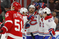 Montreal Canadiens defenseman Jeff Petry, facing camera, celebrates his goal against the Detroit Red Wings during the first period of an NHL hockey game Tuesday, Feb. 18, 2020, in Detroit. (AP Photo/Paul Sancya)