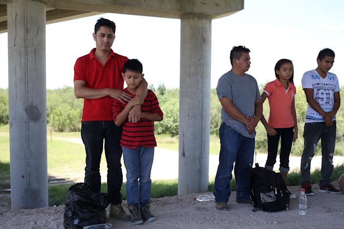 Guatemalan immigrant families turn themselves in to U.S. Border Patrol near McAllen, Texas, on May 8, 2018.