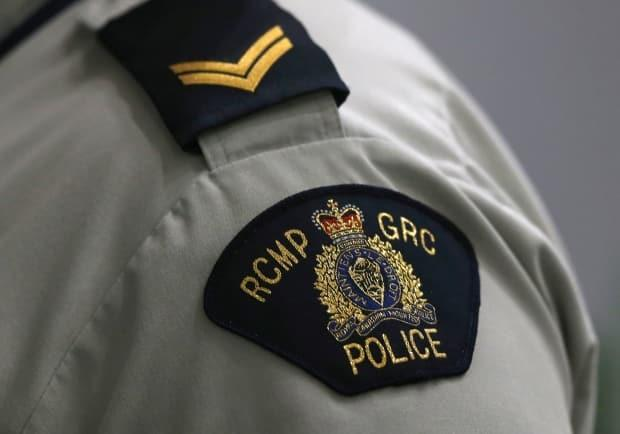 RCMP say no one was injured when the suspect's vehicle crashed into three police cruisers blocking the road. (Shannon VanRaes/Reuters - image credit)