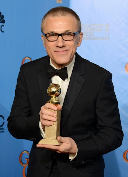 """Christoph Waltz poses with the award for best performance by an actor in a supporting role in a motion picture for """"Django Unchained"""" backstage at the 70th Annual Golden Globe Awards at the Beverly Hilton Hotel on Sunday Jan. 13, 2013, in Beverly Hills, Calif. (Photo by Jordan Strauss/Invision/AP)"""